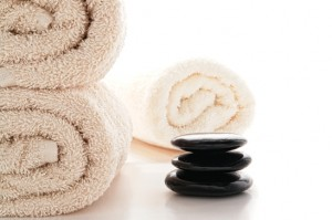 Polished Hot Massage Stones Cairn and Bath Towels